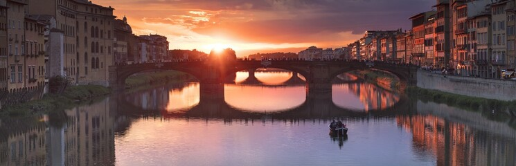 orange sunset in panorama of river and bridge in Florence in Italy