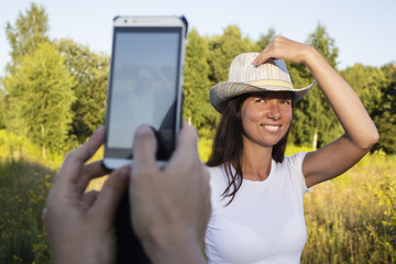 young woman taking photos, mobile camera