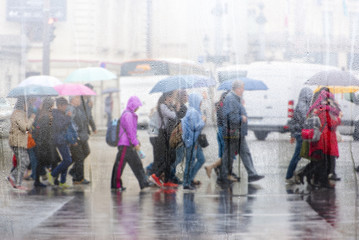People crossing road during the rain