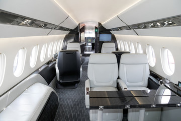 Modern business jet aircraft interior cabin view.