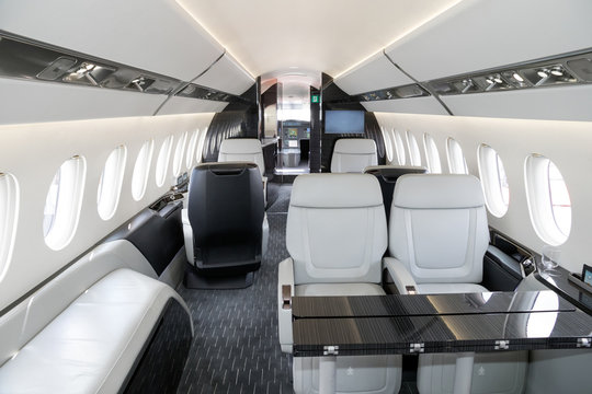 Modern business jet aircraft interior cabin view.