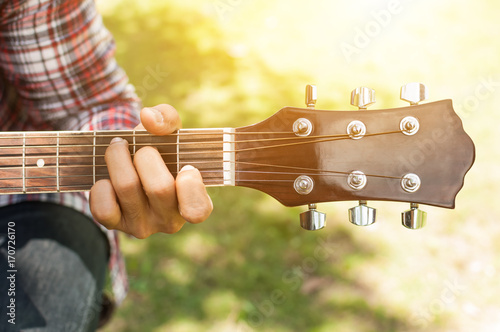 The Country Man Is Playing Guitar In The Garden Handsome Cowboy Is