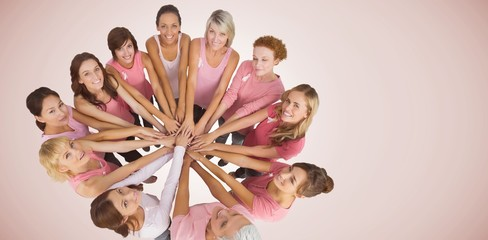 Composite image of portrait of happy female friends supporting