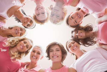 Composite image of low angle portrait of female friends