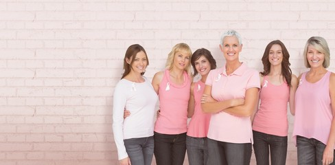 Composite image of portrait of confident women supporting breast