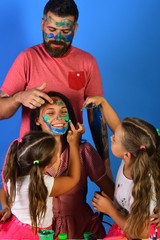 Artists create gouache artwork on ladys face. Parents and children