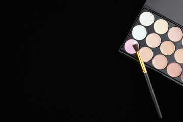 Beauty concept. Cosmetic accessories on black background from top view or flat lay.