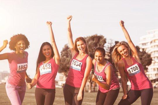 Cheering women supporting breast cancer marathon