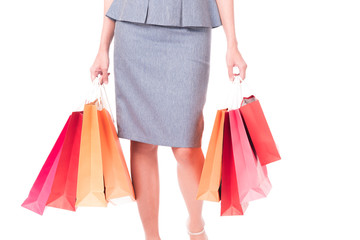 Closed up ,Hands of business women carrying colorful shopping bags isolated on white background