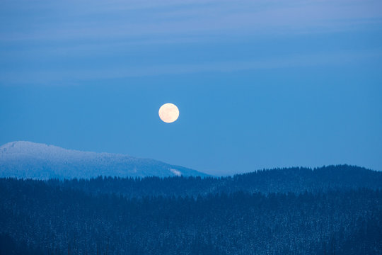 Full moon rising over winter Smoky Mountains