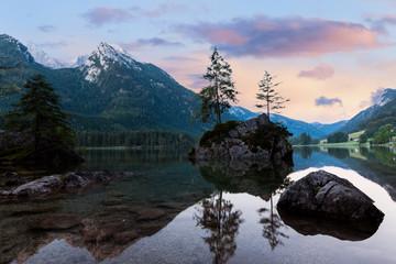 Alpine mountain lake at cloudy colorful sunrise