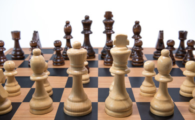 Close up of chess pieces on a board.