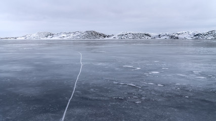 cold winter morning on the lake / huge piles of broken ice oz natural structures