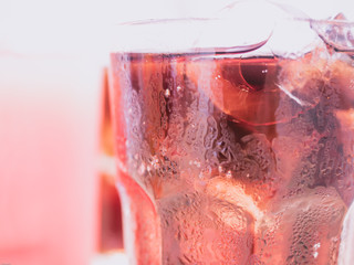 close up sparkling water with ice with soft focus background for summer and fresh