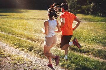 Happy couple running and jogging together