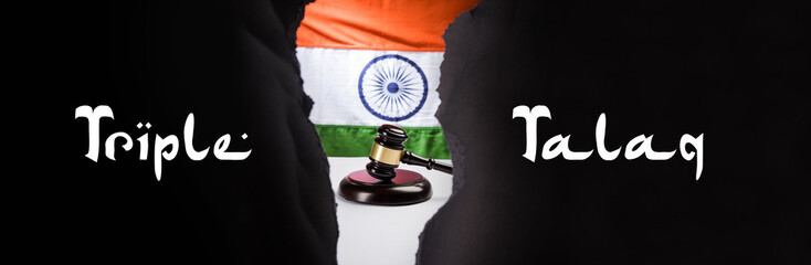 stock photo on triple talaq law in India - Triple talaq which is banned by supreme court of India. Concept showing gavel, indian flag and text over  wooden blocks