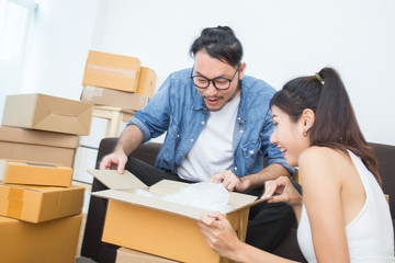 Couple Asian People Open the Box with Happy Emotion, People Feeling Surpise Togrther, People Moving Concept