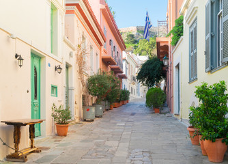 small paved street of Placa district with Acropolis hill in Athens, Greece
