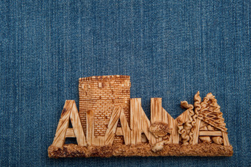 Magnet on the refrigerator. It is dedicated to the Turkish city of Alanya. Denim as a background.