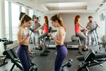 Beautiful woman wokring out in gym