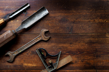 Old tools on table top, textured flat lay