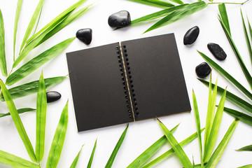 Bamboo leaf background. Black sketchbook spread notebook mockup.