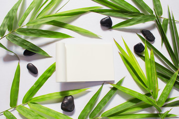 Blank page and green bamboo leaf background. White sketchbook horizontal mockup.