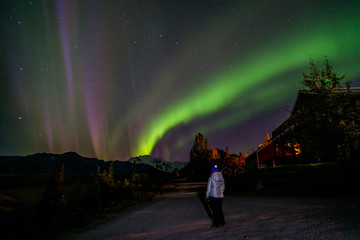 The girl in Alaska looks at the northern light