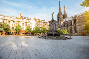 Morning view on the Victory square with monument and cathedral in Clermont-Ferrand city in France Wall mural