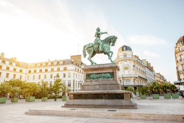 View on the Martroi square with statue of Saint Joan of Arc in Orleans city during the sunset in France