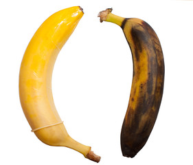 Safe sex with condom and unprotected sex leading to disease. Concept. Healthy banana in a condom and a rotten banana without a condom