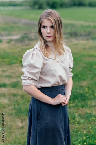 Slender woman in an vintage dress in fairy park. mystery of the manor. Pride 5af3bebb6f7