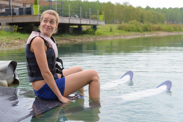happy young girl learning on a water ski