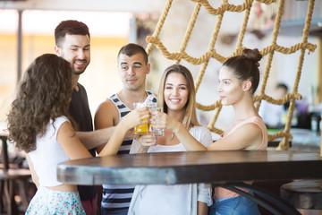 Friends having fun and toasting at a bar