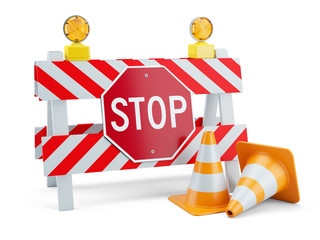 Road sign STOP on fence and traffic cones