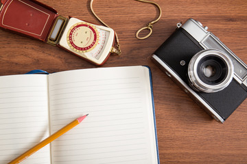 old Camera and light meter with notebook