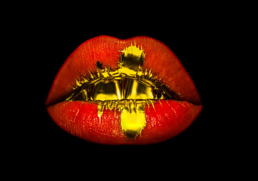 Lip drip background, gold on red pink female sexy lips isolated on black background. Fashionable lipstick, cosmetics concept. Golden teeth and oral sex, girl or woman creative make-up. Luxury glamour