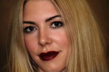 Closeup portrait of a beautiful young blonde woman