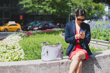 Young woman in blazer on phone
