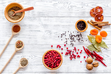 Spicy food cooking with spices and dry herbs light wooden kitchen desk background top view mockup