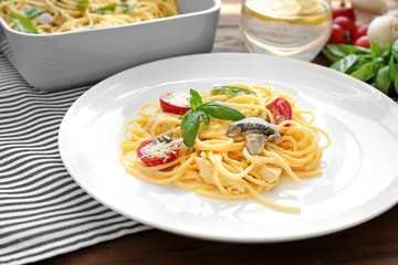 Plate with delicious roasted turkey tetrazzini on table