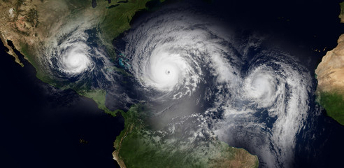 Extremely detailed and realistic high resolution 3d illustration of 3 hurricanes approaching the Caribbean Islands and Florida. Shot from space. Elements of this image have been furnished by Nasa.