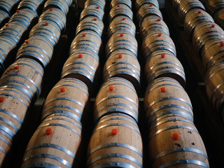 Lines of whiskey casks played on factory floor