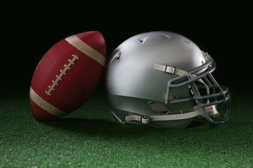 American football leaning on headgear