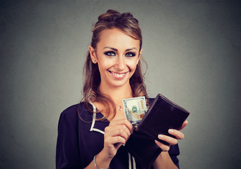Happy cute woman with money in her wallet