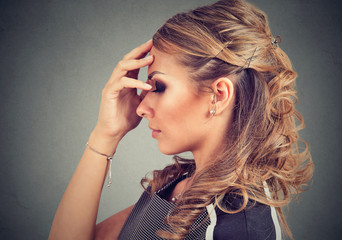 Serious young woman thinking very hard
