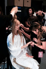 A model gets her hair and makeup done backstage before the Noon by Noor Spring Summer 2018 collection show during New York Fashion Week in the Manhattan borough of New York City, U.S.