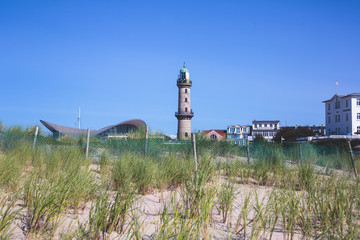 Beautiful summer vibrant view of Warnemunde, Rostock, Germany, popular german seaside resort, with beach, seashore and lighthouse