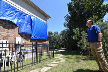 Farmers Insurance claims adjuster Brent Hazen assesses a home damaged by Hurricane Harvey in Missouri City Texas
