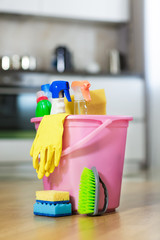 Plastic bucket with cleaning product at home